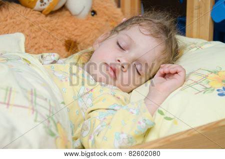 Three Year Old Girl Sleeping In Her Crib