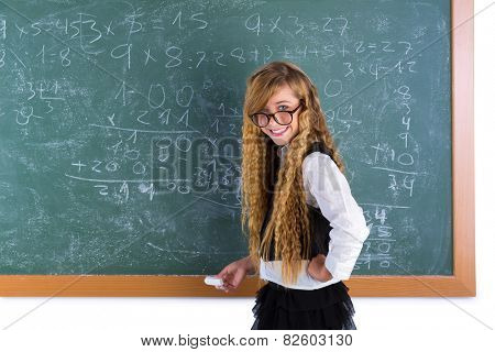 Clever nerd pupil blond girl in green chalk board student schoolgirl