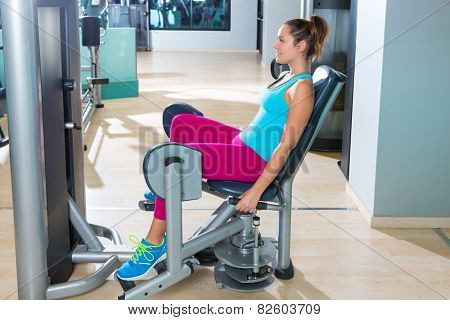 Hip abduction woman exercise at gym indoor opening legs workout