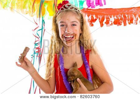 happy party girl with puppy present eating chocolate in birthday dirty mouth