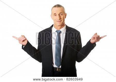 Portrait of businessman with hands on both sides.
