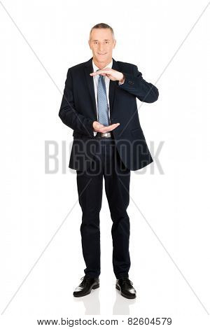 Full length businessman displaying invisible product.