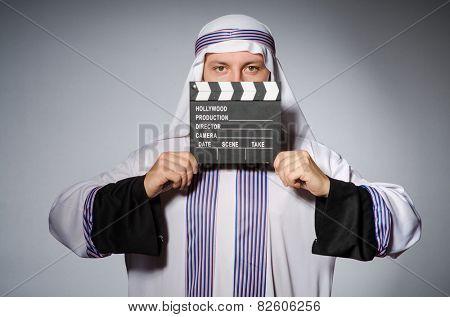 Arab businessman with movie board