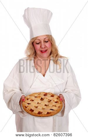 A baker holds her signature apple pie for you the customer. isolated on white with room for your text
