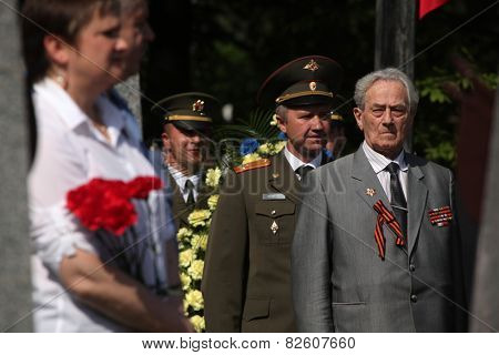 PRAGUE, CZECH REPUBLIC - MAY 9, 2013: Soviet war veterans attend the celebration of Victory Day at the Soviet War Memorial at the Olsany Cemetery in Prague, Czech Republic.