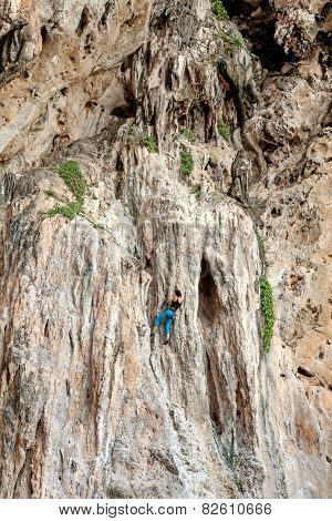 Incredible Wall And Young Woman Climbing, Concept For Overcoming Obstacles.