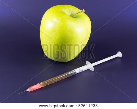 Yellow Apple and Hypodermic Syringe