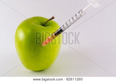 Golden Yellow Apple and Hypodermic Syringe
