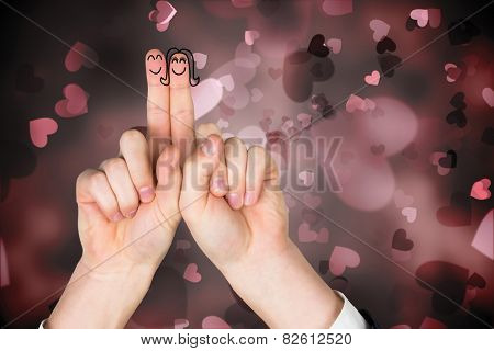 Fingers crossed like a couple against valentines heart design
