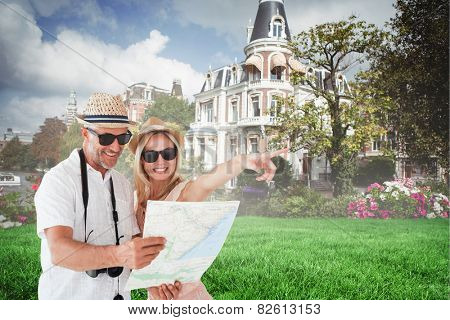 Happy tourist couple using map and pointing against sunny day by the river