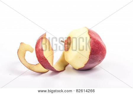 red cut apple with spiral skin, side view. Isolated on white background