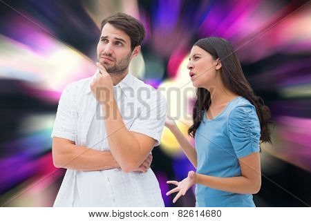 Angry brunette shouting at boyfriend against twinkling yellow and purple lights