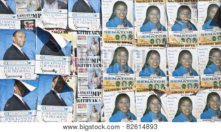 NAIROBI, KENYA-FEBRUARY 18, 2013: A wall is covered with political posters for the national election in Kenya.