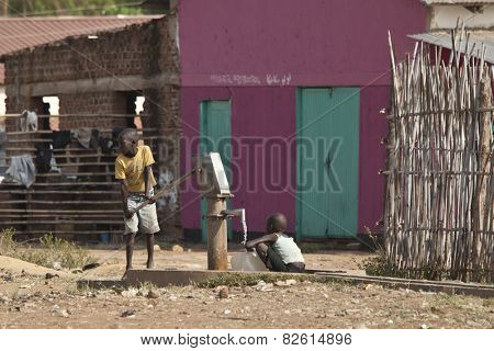 TORIT, SOUTH SUDAN-FEBRUARY 20, 2013: Unidentified children pump water from a well in South Sudan