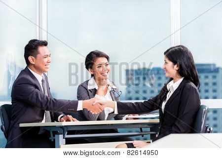 Asian recruitment team hiring candidate in job interview