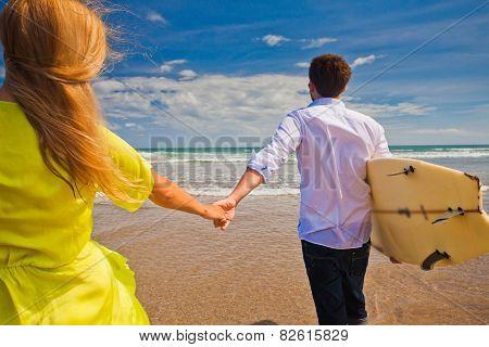 Honeymoon Lovers Couple Near The Beach With Surfboard