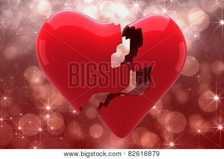 Broken heart against shimmering light design on red