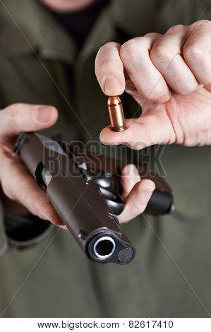 Soldier Shows Pistols And Ammunition