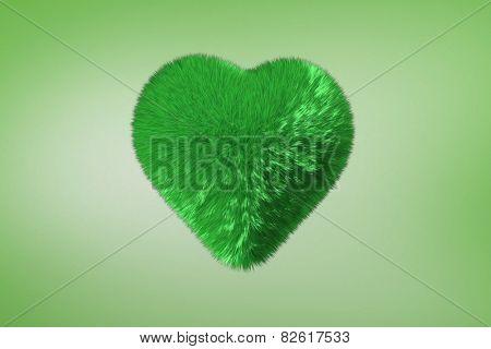 Green fuzzy heart against green vignette