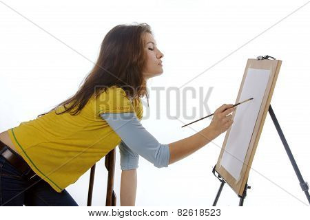 Woman Artist Draws On Her Easel