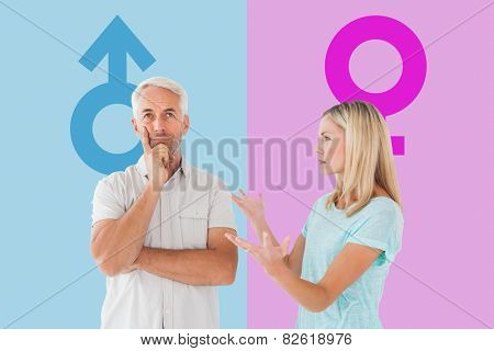 Unhappy couple having an argument with man not listening against pink and blue