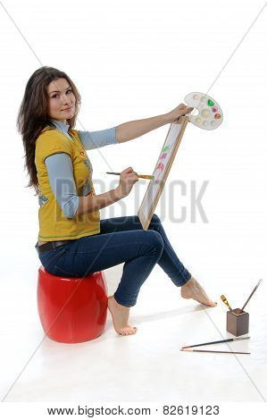 Woman Artist Sitting Sideways To The Camera Holding An Ease
