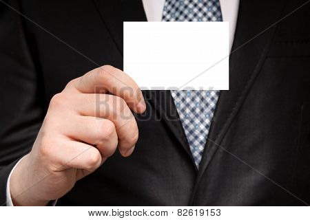 Businessman In A Suit Holding A White Business Card
