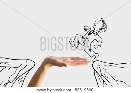 Human hand and caricature of businessman jumping above gap