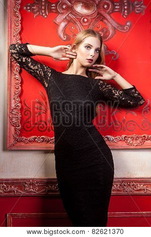 Sexy Woman In Black Dress On Red Vintage Wall