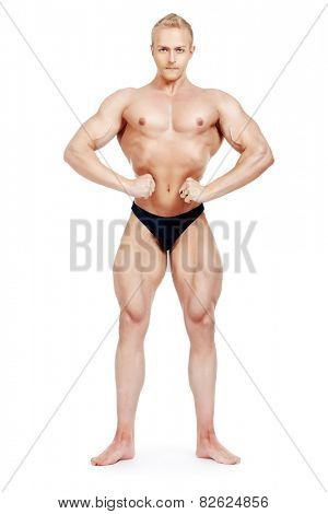 Full length portrait of professional sportsman bodybuilder man. Isolated over white.