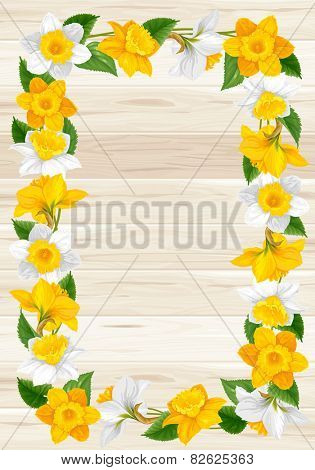 Retro frame from daffodils flowers on wooden background