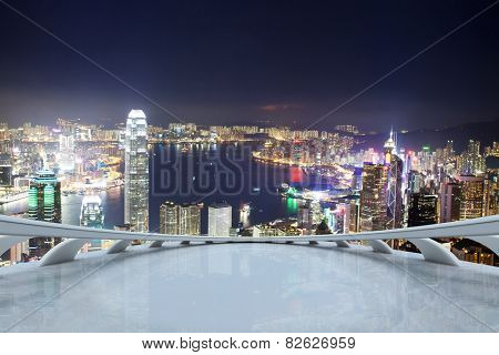 Empty viewing deck with Hong kong night scene