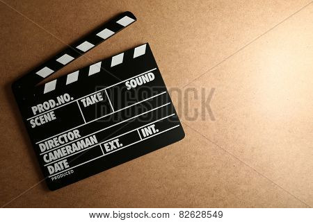 Movie clapper on wooden background