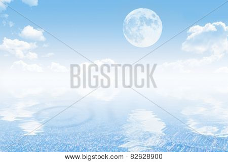 Cloudy sky with moon and tranquil sea