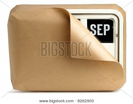 September Office Clock Calendar Wrapped Up In Brown Paper