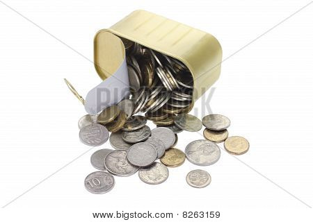 Coins Spilling Out Of Tin Can