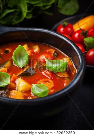 Homemade delicious ratatouille soup with basil