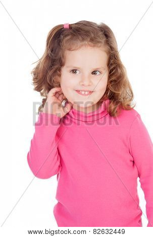 Shy little girl in pink isolated on a white background