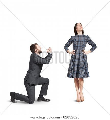 sad and crying man apologizing to young beautiful woman. isolated on white background