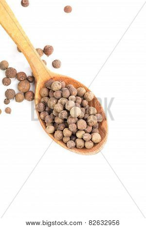 Aromatic Allspice In Wooden Spoon On White Background