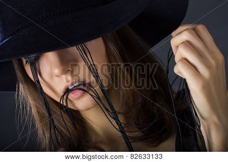 Girl With Long False Eyelashes In The Hat