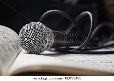Microphone On Sheet Of Music