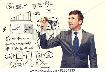 business, finances, economics and office concept - attractive buisnessman drawing plan on virtual screen