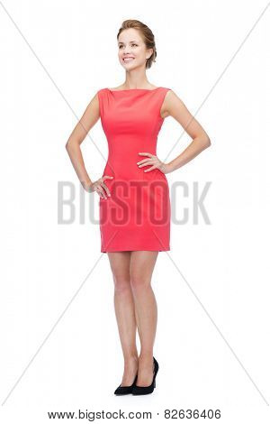 happiness and people concept - smiling young woman in red dress