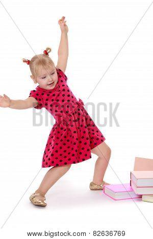 Funny little girl raised her hands up.
