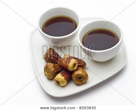 Dates with two cups of black coffee