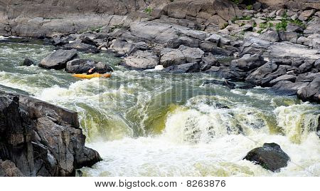 Kayaker Running Rapids