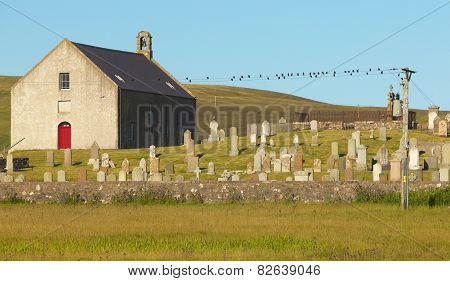 Scottish Landscape With Church And Cemetery In Shetland. Scotland. Uk