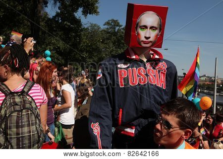 PRAGUE, CZECH REPUBLIC - AUGUST 17, 2013: Young gay man carries a dummy with the face of Russian president Vladimir Putin during the Prague Gay Pride Festival in Prague, Czech Republic.