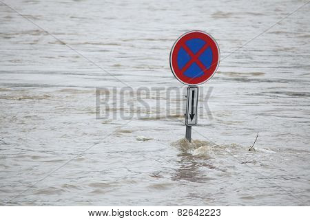 PRAGUE, CZECH REPUBLIC - JUNE 3, 2013: No stopping, a traffic sign partially flooded by the swollen Vltava River in Prague, Czech Republic.
